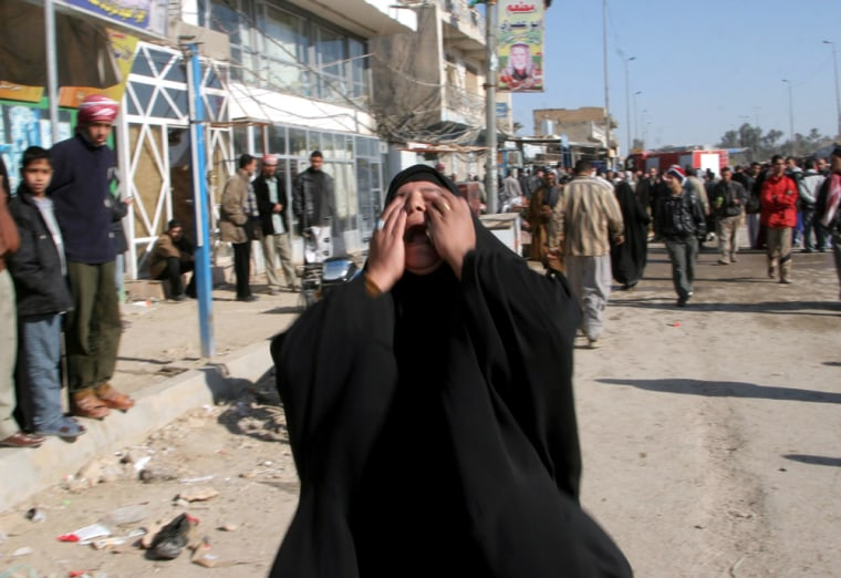 An Iraqi woman cries near the explosion in Kufa, 100 miles south of Baghdad, Iraq, on Saturday.