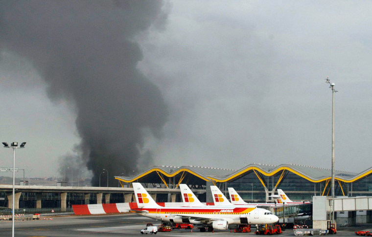 Smoke rises above one of the parking lots of Madrid's Barajas airport after an explosion