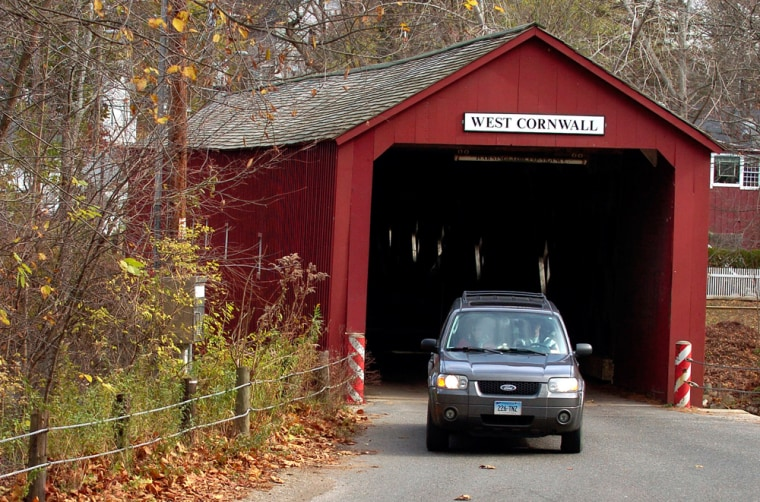 A vehicle is pictured driving out of the West Cornwall Bridge in Sharon, Conn. The bridge, listed on the National Register of Historic Places, spans 172 feet across the Housatonic River between the towns of Cornwall and Sharon.