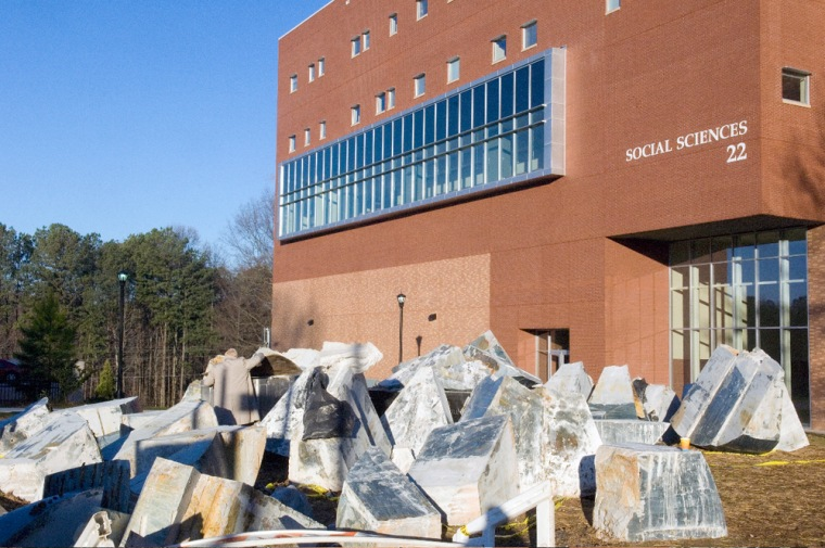 """""""Spaceship Earth"""" sits in a pile of stone and bronze after falling apart on the campus of Kennesaw State University, in suburban Atlanta."""