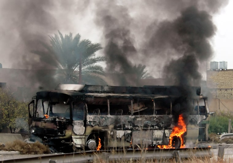 Unknown gunmen attacked a bus full of mainly Shiite workers en route to the Baghdad airport on Monday. More than a dozen people were killed.