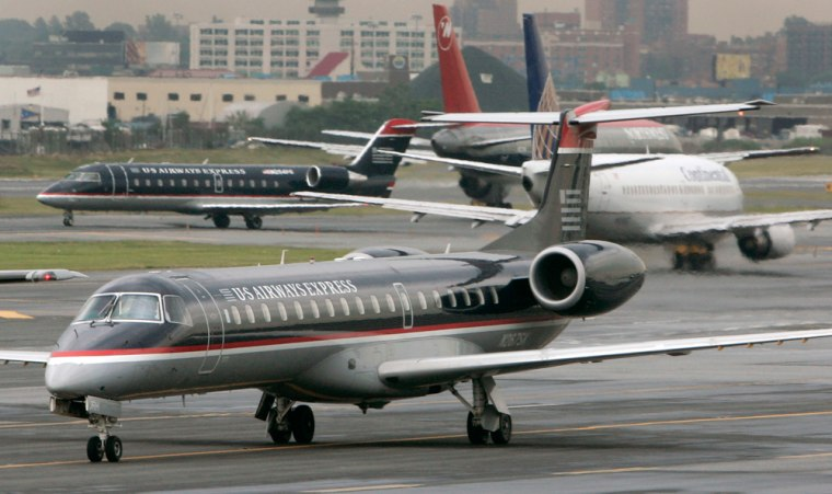 Commercial jetliners are seen the tarmac at LaGuardia airport in this file photo. Already one of the most congested airports in the country, the Port Authority of New York and New Jersey believes it may be possible to move an additional 8 million passengers a year through the airport.