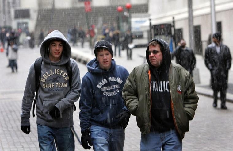 Three young men walk down Broad Street a