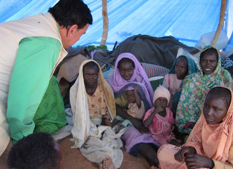 New Mexico Gov. Bill Richardson, left, speaks Tuesday with women living in the As Salaam camp in Sudan's Darfur region.