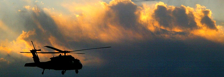 A helicopter from the NATO-led International Security Assistance Force patrols the sky over Kabul, Afghanistan, on Thursday.