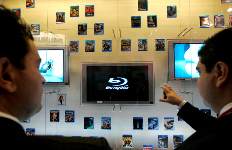 Attendees at the Consumer Electronics Show Show look at Sony's Blu-ray movie display.