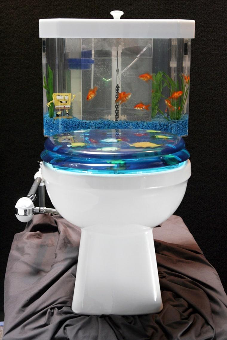 Undated handout Photo of a Fish 'n Flush toilet tank