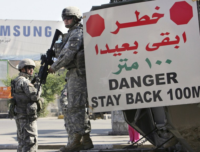 File photo of U.S. soldiers from 172nd Stryker Brigade Combat Team standing guard at a checkpoint in Baghdad