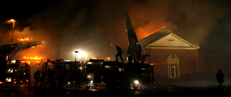 Firefighters work Saturday at the scene of a fire at the Memorial Baptist Church, in Greenville, N.C.