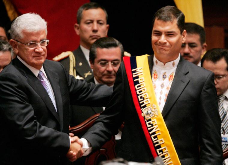 Ecuador's President Rafael Correa shakes hands with former President Alfredo Palacio in Quito