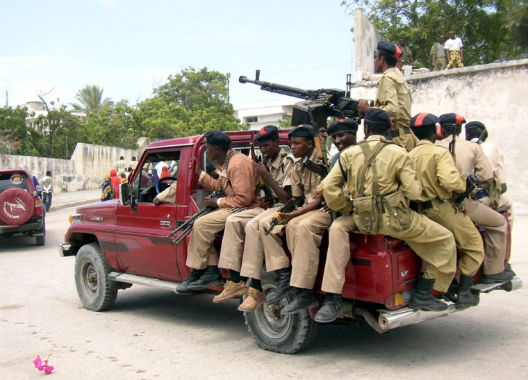Somali government soldiers on patrol outside the presidential palace in the capital, Mogadishu, on Monday.
