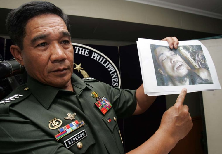 Philippine Armed Forces Chief Gen. Hermogenes Esperon Jr. shows a photo taken of killed Abu Sayyaf leader Jainal Antel Sali Jr., also known as Abu Sulaiman, during a news conference at their headquarters in Quezon city, Philippines, on Wednesday.