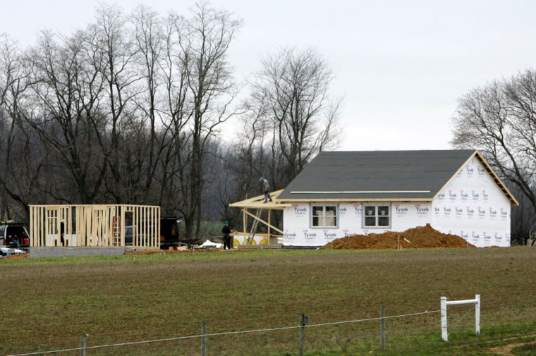 Men are seen working Thursday on structures in Nickel Mines, Pa. A new Amish schoolhouse is rising a few hundred yards from the former site of the school where a gunman shot 10 girls in October, killing five of them.