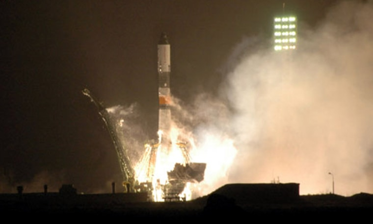 A Soyuz booster rocket lifts off from Russia's Baikonur Cosmodrome onThursday, sending an unmanned cargo craft to the international space station.