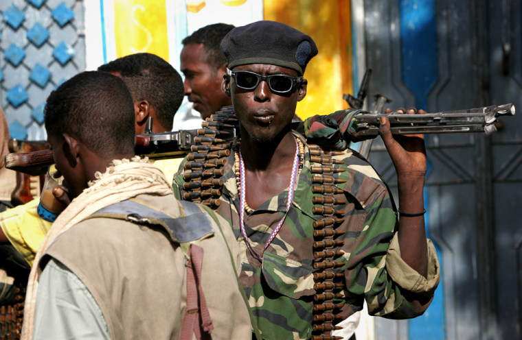 Militiamen with the Islamic Courts Union walk in Balad, Somalia, in June, just months before Ethiopian troops invaded the country to crush the movement.