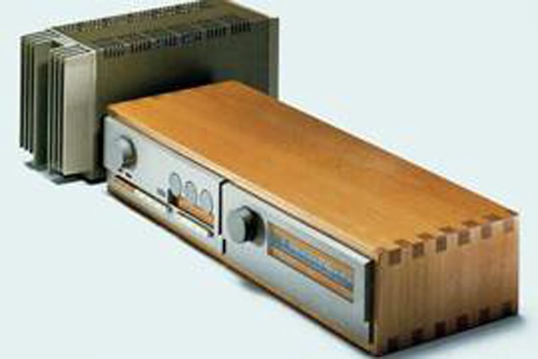 From left to right, the Quad 303 power amp, 33 pre-amp and matching FM3 tuner.