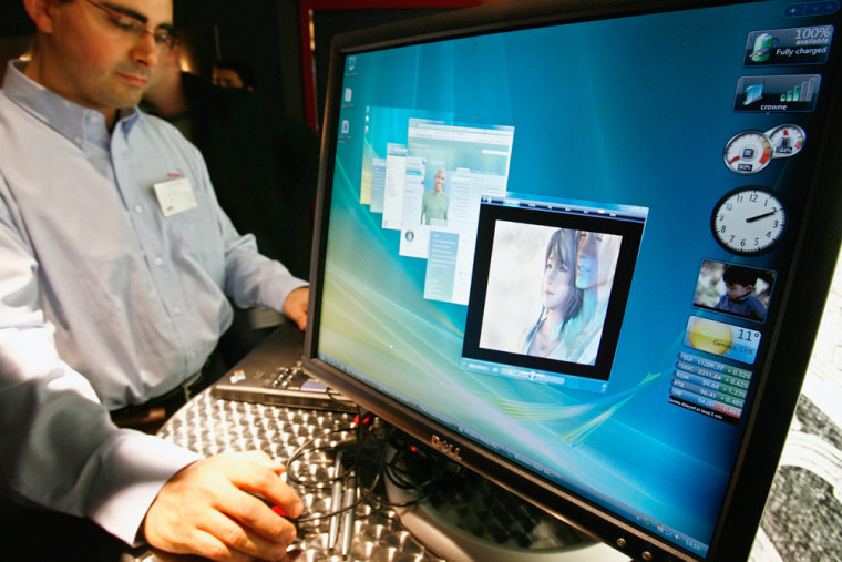A staff member of Microsoft Switzerland demonstrates the American company's latest operating system, Windows Vista, at a news conference.