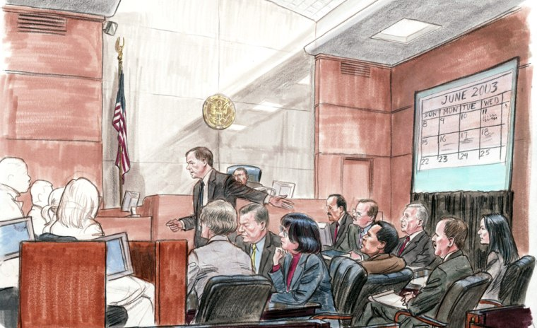 Special Counsel Patrick Fitzgerald addresses the jury, gesturing toward I. Lewis Libby (third from right).
