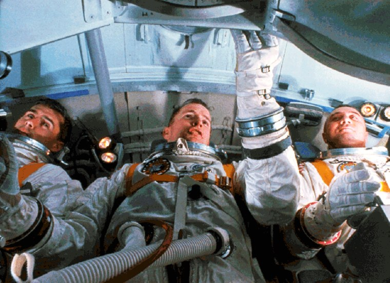 Roger Chafee, Ed White and Gus Grissom practice their tasks in preparation for a launch that never took place. The three astronauts died 40 years ago in the Apollo 1 fire.