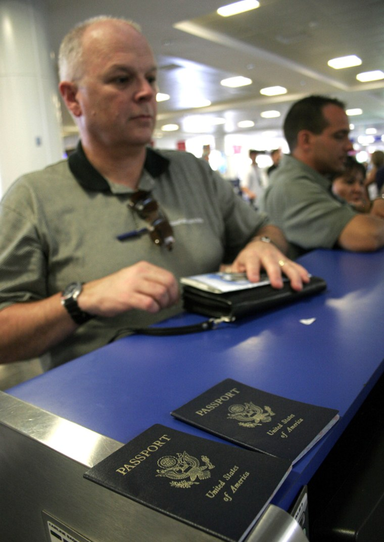 Bill Moore, 56, from Denver, Colo.,checks in at an airline counter in the resort city of Cancun, Mexico, on the day new American regulations designed to enhance security took effect.