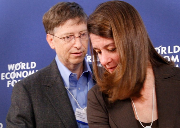 Bill Gates, Chairman of Microsoft, left, and Melinda French Gates, arrive at a press conference during the World Economic Forum in Davos, Switzerland, on Friday.