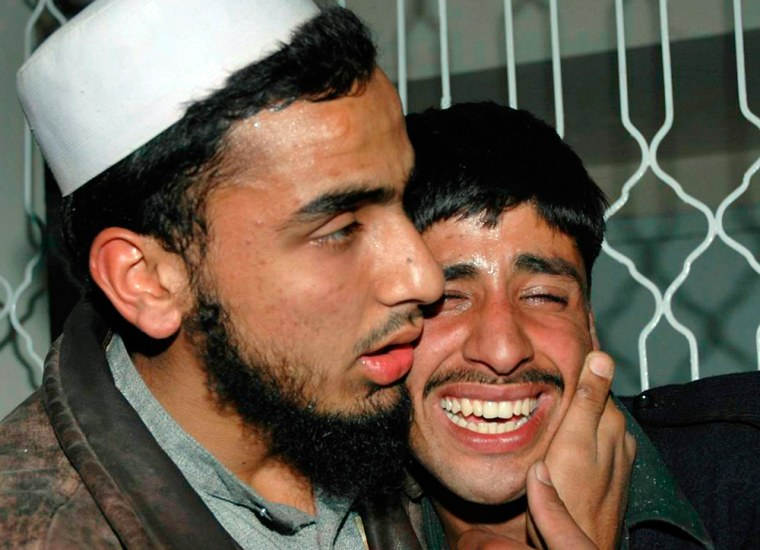 Pakistani policeman cries over the death of his comrade after bomb explosion in Peshawar