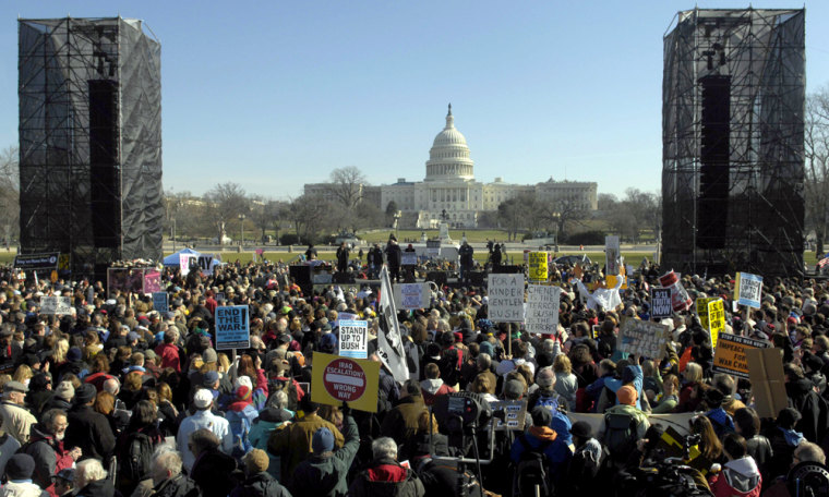 Demonstrators listen to the speakers during a protest against the war in Iraq on the National Mall in Washington on Saturday.