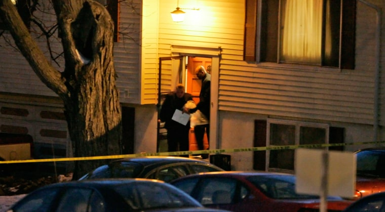 Investigators carry bags fromthe house in Omaha, Neb., on Sunday,where the shootings occurred.