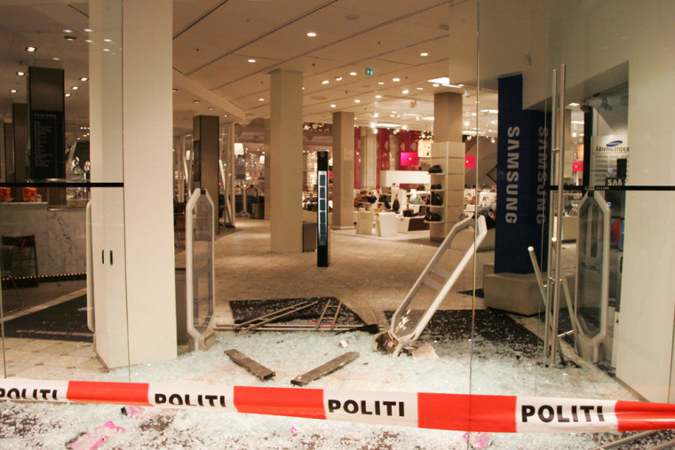 Police in Copenhagen, Denmark, have secured the scene of an attempted robbery in which the would-be thieves raced their car through the ground floor of a department store.