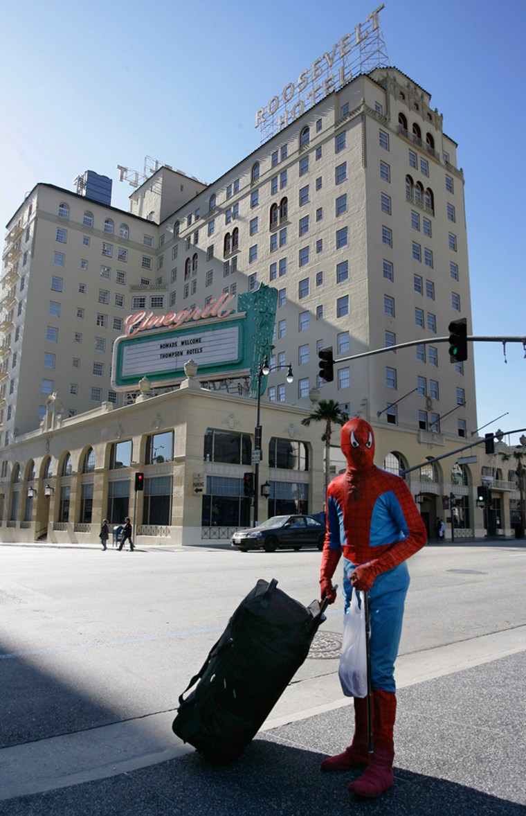 A Spiderman impersonator crosses the street with his luggage near the Roosevelt Hotel in Hollywood. The hotel is a perfect spot to get a sneak peak at stars attending the 79th annual Academy Awards on Feb. 25.