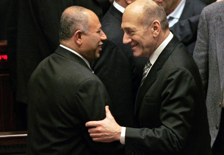 Israeli Prime Minister Ehud Olmert, right, congratulates Raleb Majadele Monday after the Muslim Arab became a Cabinet minister.