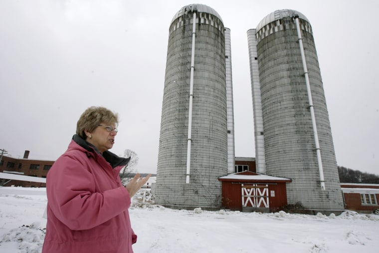 Superintendent Anita Carbonell stands by old silos at the Southeast State Correctional Facility in Windsor, Vt., earlier this month. Carbonell has decided that cats living in the nooks and crannies of the prison facilities must go.