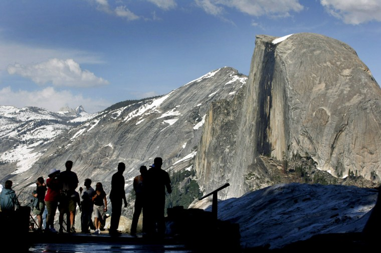 Visitors view Half Dome from Glacier Point at Yosemite National Park.