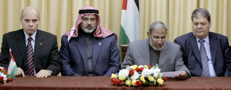 The head of the Egyptian security delegation Raafat Shihade, left, Palestinian Authority Prime Minister Ismail Haniyeh from Hamas, Palestinian Foreign Minister Mahmoud al-Zahar and Rauhi Fattouh, an envoy of Palestinian President Mahmoud Abbas, attend a press conference in Gaza City early Tuesday as a tenuous cease-fire between Hamas and Fatah began to take hold in the Gaza Strip.