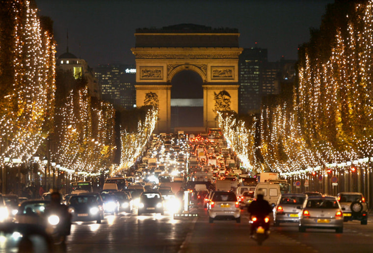 Christmas lights illuminate the Champs-Elysees Avenue in Paris