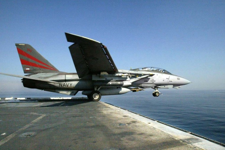 A U.S. Navy F-14A Tomcat takes off from the USS Kitty Hawk in the Persian Gulf on March 20, 2003.
