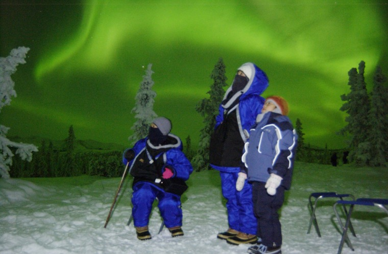 Tomoka Mizutani, 7, right, her mother Keiko, 36, middle, and her grandmother Ikuko Sugiur, 64, left, of Okazaki, Japan, watch the northern lights dance in the sky near Fairbanks Alaska. At least 3,500 tourists are scheduled to take advantage of 10 direct charter flights from Tokyo, Osaka and Nagoya to Fairbanks during the auora season.