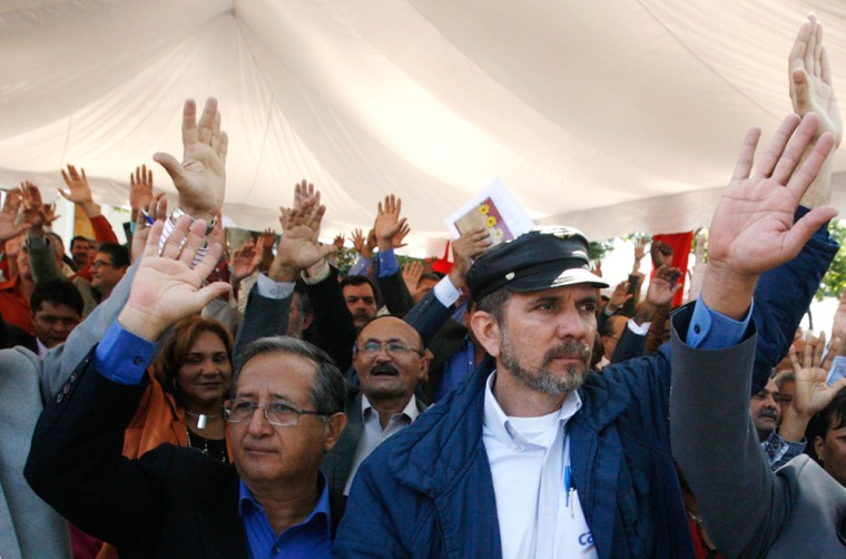 Venezuelan congressmen vote during an open-air National Assembly session in Caracas