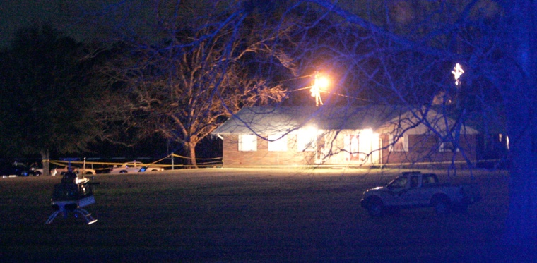 The home of Jackson County Sheriff John McDaniel became a crime scene as his wife, Mellie, a deputy and two suspects were shot and killed on Tuesday in Marianne, Fla.