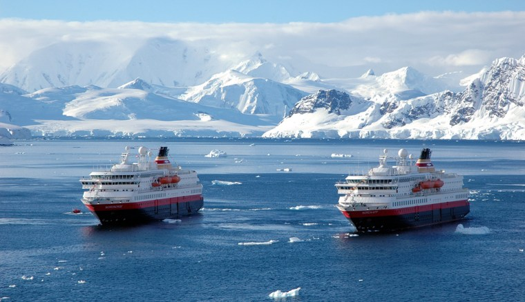 This Dec. 5, 2005, file photo shows the M/S Nordnorge, left, and M/S Nordkapp in Paradise Bay, Antarctica. The M/S Nordkappran aground off a remote Antarctic island on Wednesday.