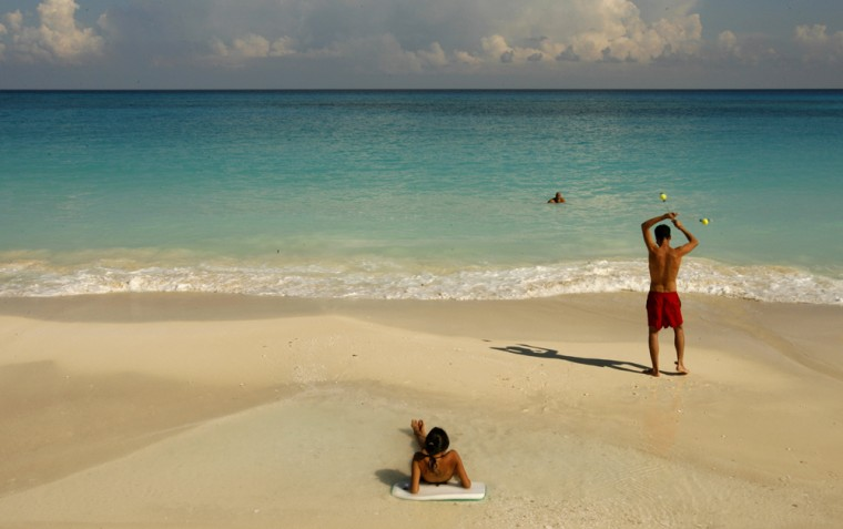 Beachgoers relax on the beach in Cancun, Mexico. What's responsible for the bracing smell of sea air? Scientists say it's the bacterial conversion of dimethylsulfoniopropionate into dimethyl sulfide.