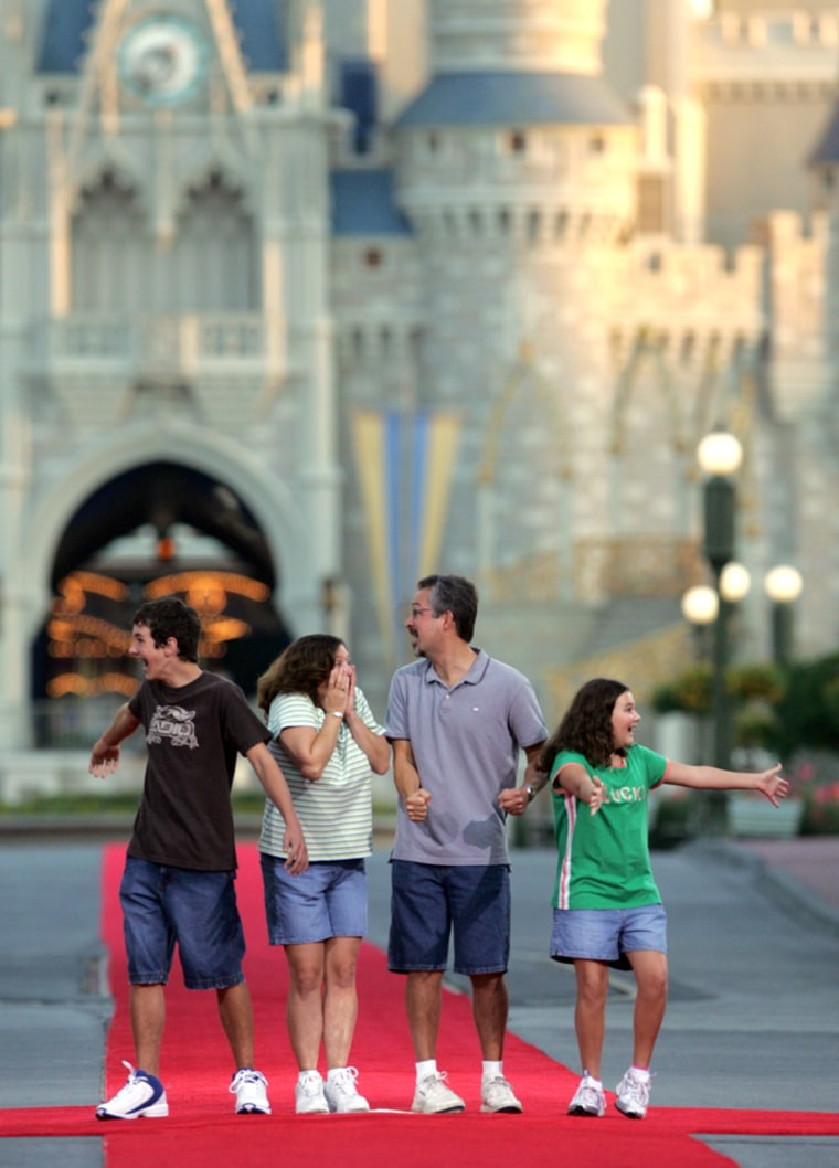 Tammy and Raymond Spangler, center, of Randolph, Ohio, with their children Derick, 13, left, and Ashley, 11, have fun at Walt Disney World last year.