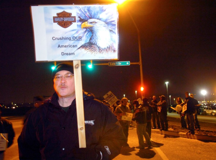 Shortly after midnight, Jim Graham, of Red Lion, Pa., pickets at the Harley-Davidson plant in Springettsbury Township, Pa.