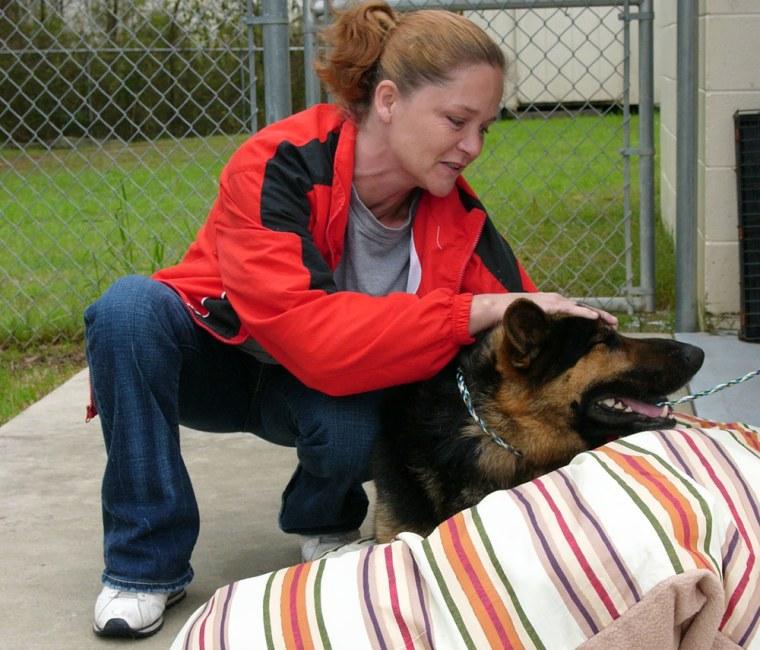 "Shannon Lorio, 36,pets ""Hero,""the German shepherd she credits with saving her life."