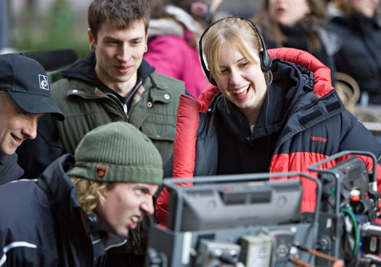 Katie Crabb, right, watches from behind the scenes during the making of her commercial. Crabb won a nationwide competition for college students sponsored by Chevrolet to design a 30-second commercial for the company's new line of crossover cars.