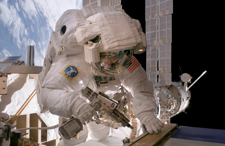 Astronaut Sunita Williams uses a pistol grip tool during construction continues of the international space station.