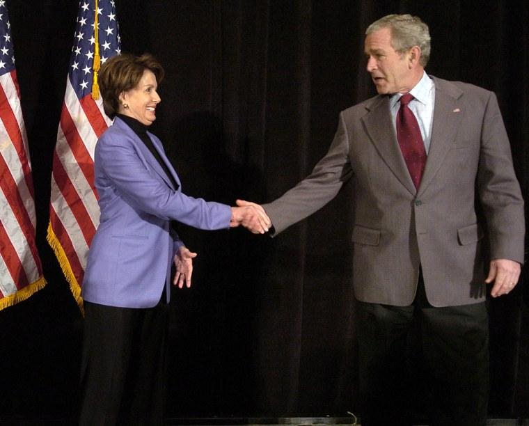 US President George W. Bush (R) shakes h