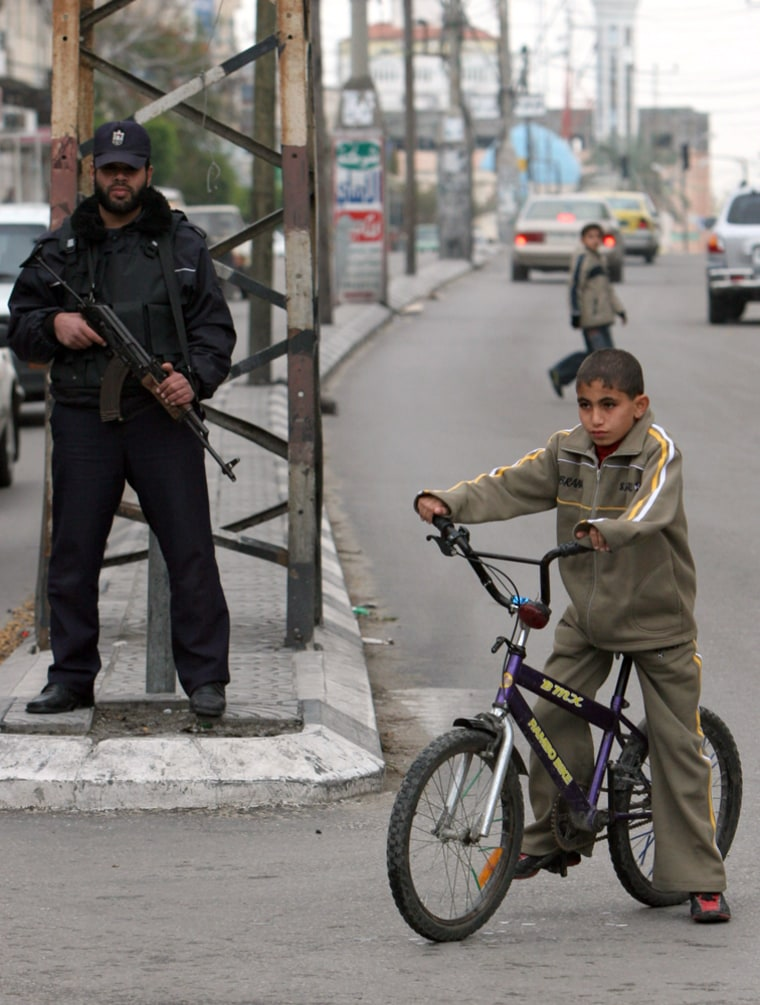 A Palestinian policeman guards a street in Gaza City on Sunday not long before a fresh cease-fire was declared that evening.