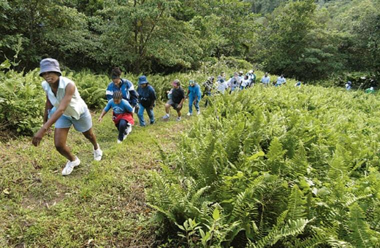 Tour guide Jadine Glitzenhirn leads a hike into the Centre Hills.