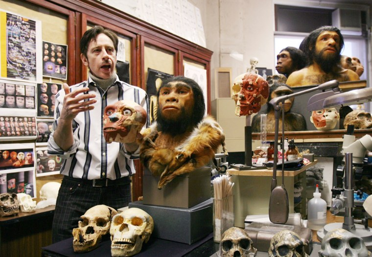 Physical anthropologist G.J. Sawyer discusses the process of making a bust from a replica of an ancient skull in a research laboratory at the new Hall of Human Origins of the American Museum of Natural History.